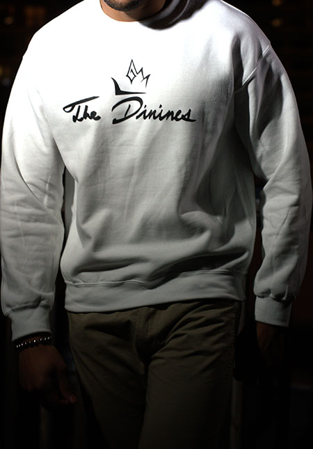 The Divines Logo crewneck sweatshirt is 50/50 cotton polyester, very soft and comfortable with a very cool design and illustration